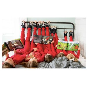 Family Reading in Bed in Matching Red Onesies
